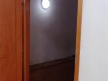 Dveře do chodby vedoucí do lóže